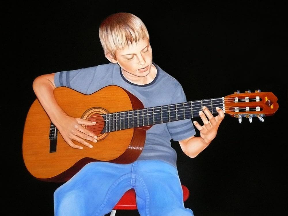 Portrait d'un enfant guitariste